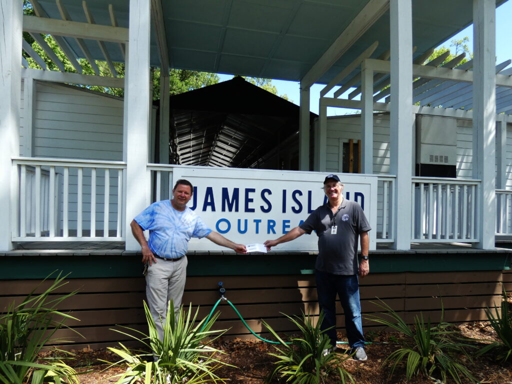 Photo of Mayor Bill Woolsey presenting JIO Director Scott Graule with a check from the Town of James Island.